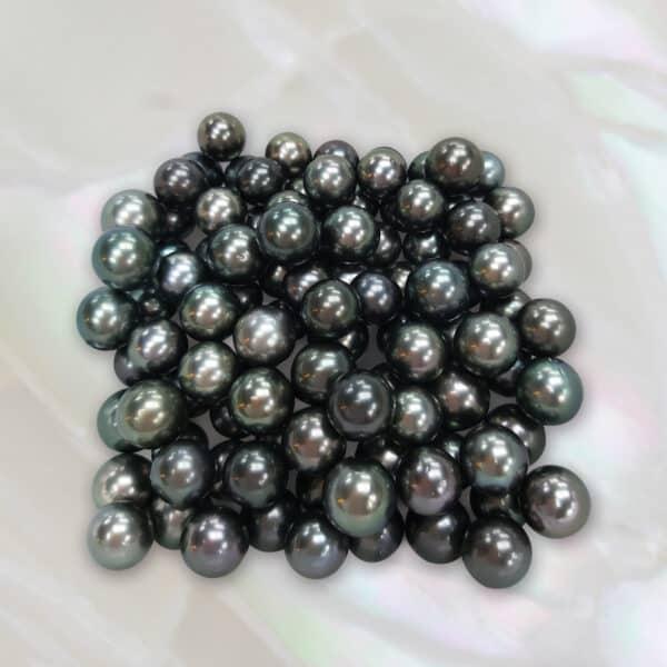 10mm round dark Tahitian pearls